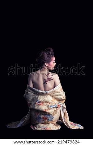 Geisha and sakura tattoo in Black Background - stock photo