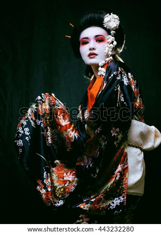 geisha in kimono on black - stock photo
