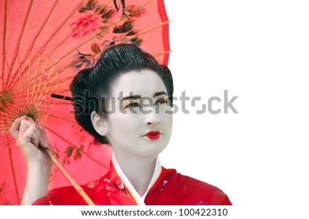 Geisha with red umbrella isolated on white - stock photo