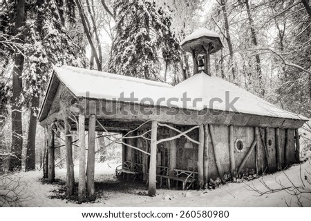 GEISINGEN, GERMANY - JANUARY 24 2015: Old Wooden Chapel in the Woods. Winter Forest. Amazing wooden architecture in the black forest of Germany.