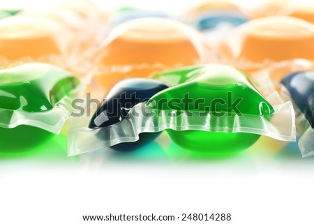 Gel capsules with laundry detergent close up - stock photo
