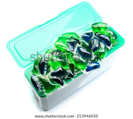 Gel capsules with laundry detergent in box isolated on white - stock photo