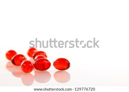 Gel pills on white background - stock photo