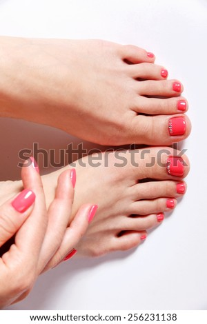 Gel polished nails and toes - stock photo