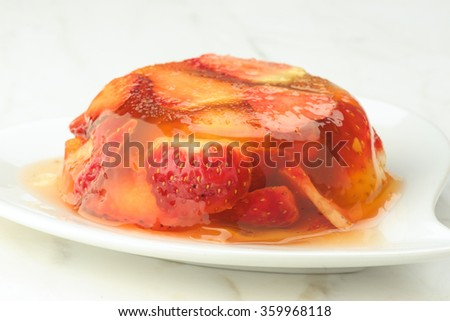 gelatin dessert and fresh strawberries on white marble - stock photo