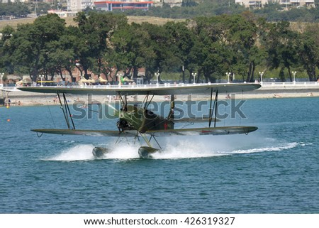 Gelendzhik, Russia - September 9, 2010: Polikarpov Po-2 vintage biplane is taxiing along the water surface after landing