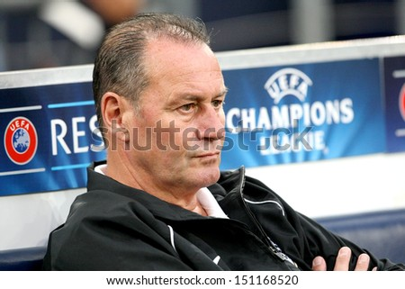 GELSENKIRCHEN, GERMANY -AUG 21: Paok's Head Coach Huub Stevens during the Champions League play-off match Schalke vs PAOK on Aug 21,2013 in Gelsenkirchen, Germany.
