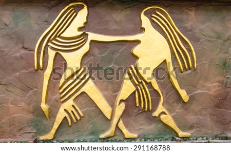 Gemini sign of horoscope on the wall - stock photo