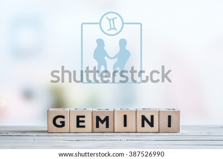 Gemini star sign on a wooden table - stock photo