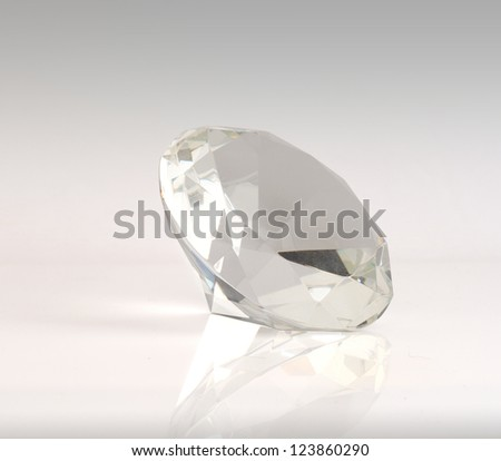 Gemstone isolated on grey background. - stock photo