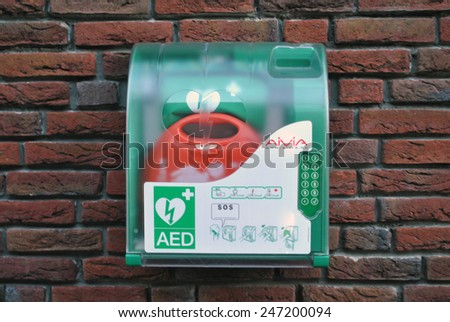 GENEMUIDEN, THE NETHERLANDS, CIRCA JANUARY 2015 - Automatic External Defibrillator in a box at a wall. - stock photo