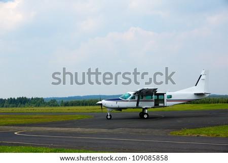 General aviation turboprop plane with skydive door - stock photo