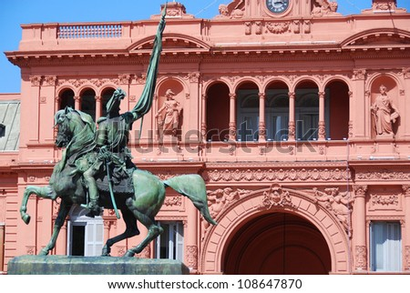 General Belgrano monument in front of Casa Rosada (pink house) Buenos Aires Argentina.La Casa Rosada is the official seat of the executive branch of the government of Argentina. - stock photo