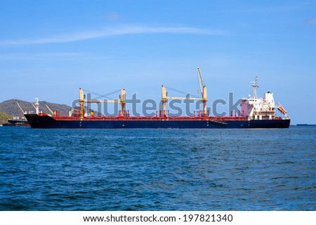 general logistic cargo ship in the sea - stock photo