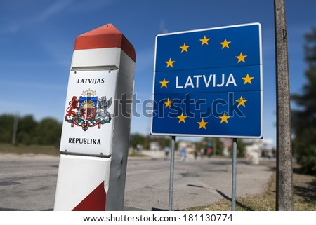 General Schengen country border sign of Latvia located on the border between Latvia and Lithuania. - stock photo