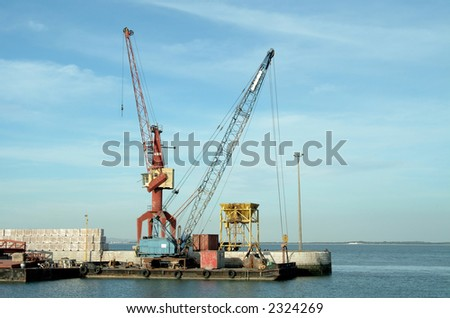 General sight of port with boats and cranes