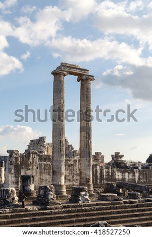 General view of ruins of Apollon Temple in Didyma Ancient City, on cloudy blue sky background. - stock photo