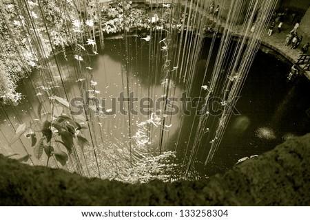 General view of the Ik-Kil cenote near Chichen Itza, Mexico (stylized retro) - stock photo