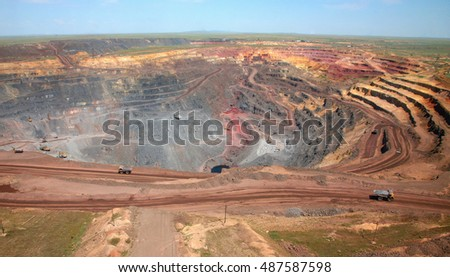 General view of the mine. Trucks carry ore
