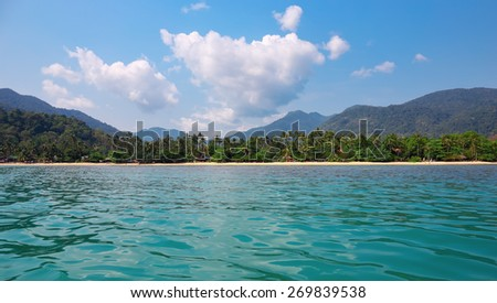 General view of the tropical island from the sea - stock photo