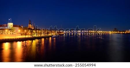 general view on Riga embankment and its illumination during nightfall, Latvia - stock photo