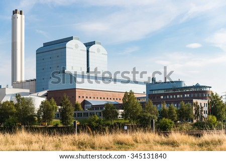 Generating plant tiefstack with smokestacks against blue sky in Hamburg.  Powerhouse in industrial technology area in Germany - stock photo