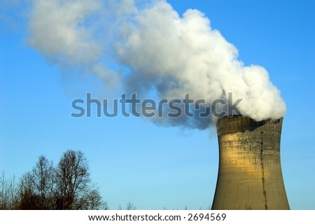 generating station with big white smoke and blue sky