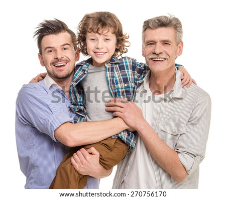Generation portrait. Grandfather, father and son looking at camera, isolated a white background. - stock photo