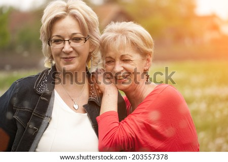 Generations: mother and daughter - stock photo
