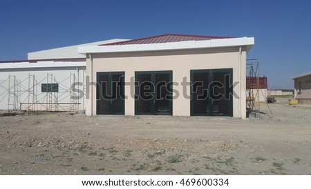 Generator and transformer room with wire cage door on the field