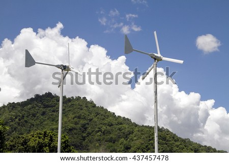 Generator from wind power with cloud and blue sky background.
