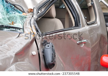 Generic compact car damaged in a rollover accident. Car crash wreck - insurance concept. - stock photo