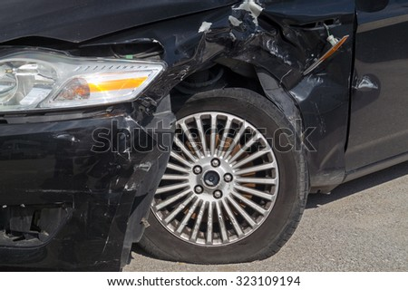Generic compact car damaged in a rollover accident. Car crash wreck - insurance concept - stock photo