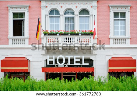 Generic detail of a cosy and romantic hotel facade with GErman and Swiss flag - stock photo