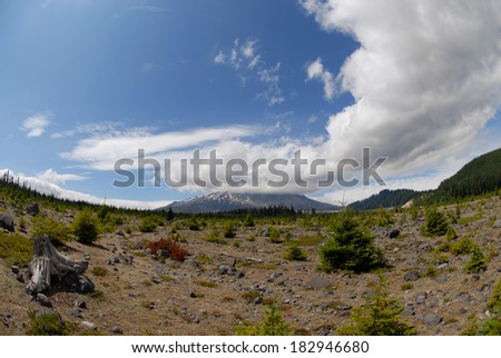 Generic fish eye view of the Mt. St. Helens volcano with a cloud hovering over the caldera. - stock photo