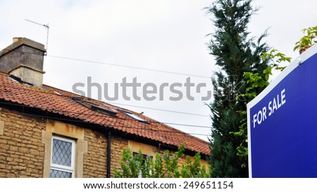 Generic For Sale Sign outside a House - stock photo
