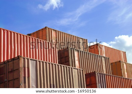 generic freight containers stacked in the port of hamburg on a sunny day - stock photo