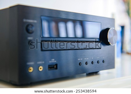 Generic Hi-Fi sound system shot - tilt-shift lens used to accent the center of the device and to emphasize the attention on central buttons - stock photo