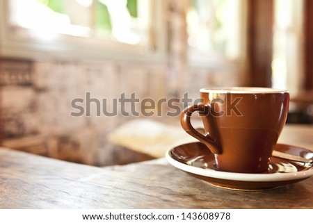 generic image of coffee in a hipster cafe, no actual coffee shown, could be any beverage, copy space too. - stock photo