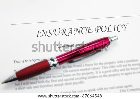 generic insurance policy with pen; could be life, auto, health etc - stock photo