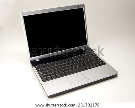 Generic Laptop with Blank Screen isolated on White Background. Real Shadow. Front View with Copy Space for Text or Image - stock photo