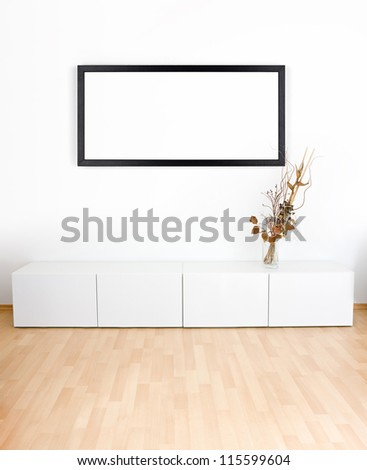 Generic modern room with shelves, wooden floor and empty black frame - stock photo