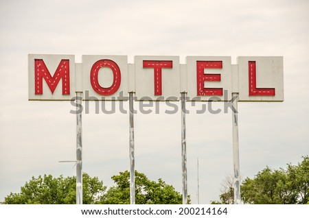 Generic motel sign in the USA with red letters on a white background - stock photo