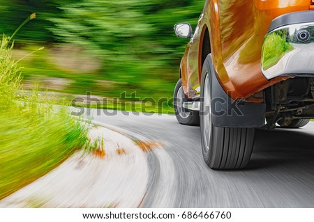 Generic pick-up truck driving fast in a curve