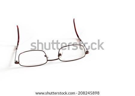 Generic reading glasses on white background - stock photo