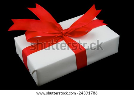 generic red and white present isolated on black background