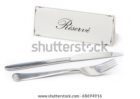 Generic reserved sign in french with fork and knife on white background