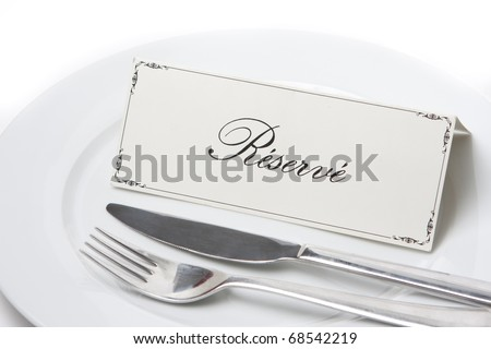 Generic reserved sign on a white plate with fork and knife - stock photo