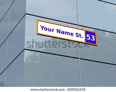 Generic street name plate attached to a glossy wall at the corner with trees and sky reflected in the panels. Rendered 3d design.