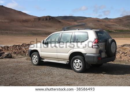Generic SUV or all terrain car in Icelandic badlands. Hverir volcanic area. - stock photo